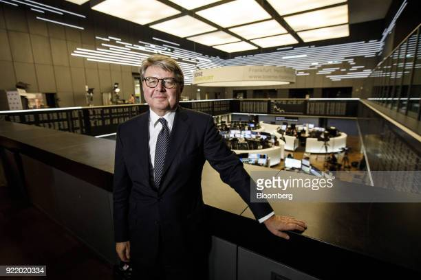Theodor Weimer chief executive officer of Deutsche Boerse AG poses for a photograph overlooking the Frankfurt Stock Exchange trading floor following...