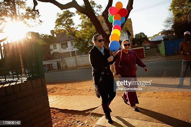 Theodora Alexandrakis and her mother Tina Alexandrakis deliver balloons with handwritten getwell wishes to the Mediclinic Heart Hospital where former...