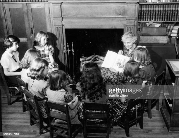 Theodora Crane leads The Story Hour at the Charlestown Girls' Club in Boston on Apr 14 1954