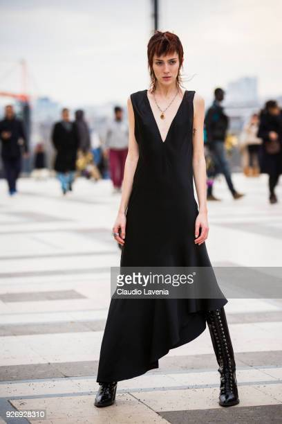 Theodora Quinlivan wearing black long dress is seen in the streets of Paris after the Haider Ackermann show during Paris Fashion Week Womenswear...