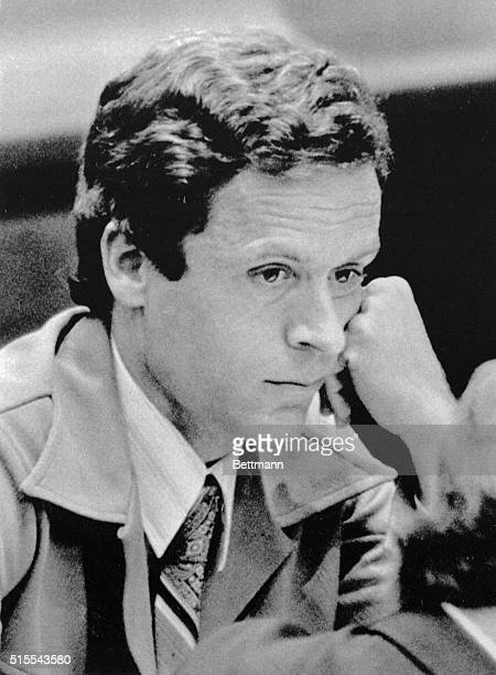 Theodore Bundy rests his head on his fist as he listens to attorneys argue the merits of his case in the pre-trial hearings prior to Bundy's trial...