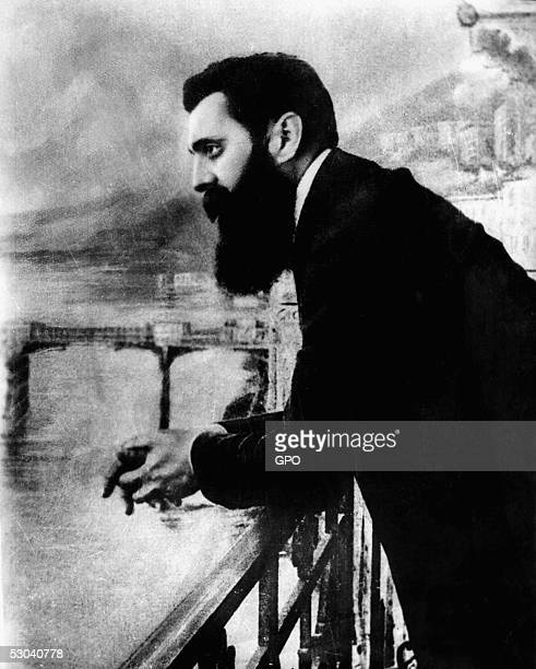 Theodore Herzl the father of modern Zionism leans over the balcony of the Drei Konige Hotel during the first Zionist congress August 29 1897 in Basel...
