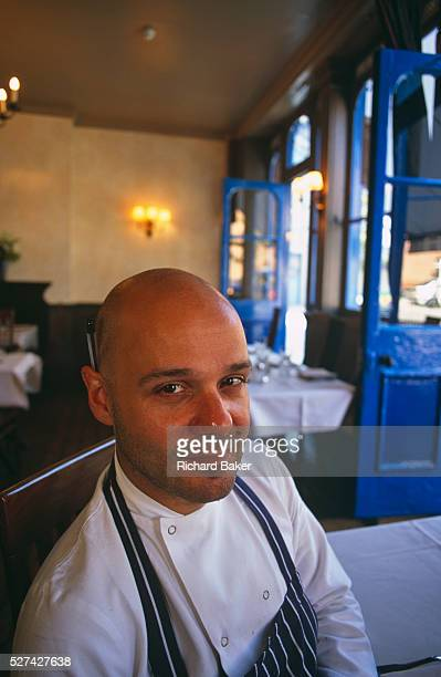 Theodore Kyriakou is seen in his Real Greek restaurant in Hoxton East London He smiles to the view dressed in chef's apron and with a pen behind his...