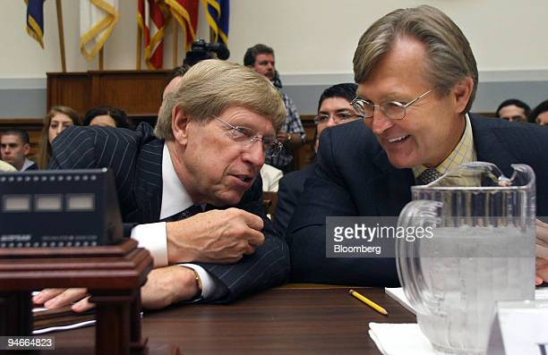 Theodore Olson, partner, Gibson, Dunn and Crutcher and former solicitor general of the Justice Department, left, chats with John D. Hutson, dean,...