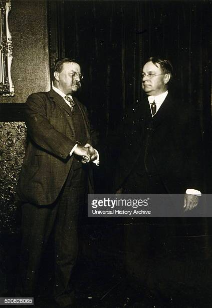 Theodore Roosevelt and Hiram Johnson standing shaking hands after being nominated as presidential candidates for the Progressive or Bullmoose party