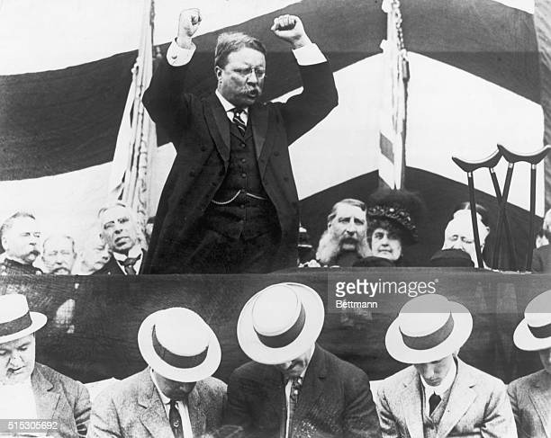 Theodore Roosevelt is shown in a typical oratorial pose arms raised Ca 1900s