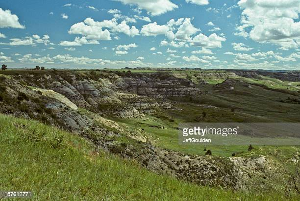 grassy canyon and cloud formation - north dakota stock pictures, royalty-free photos & images