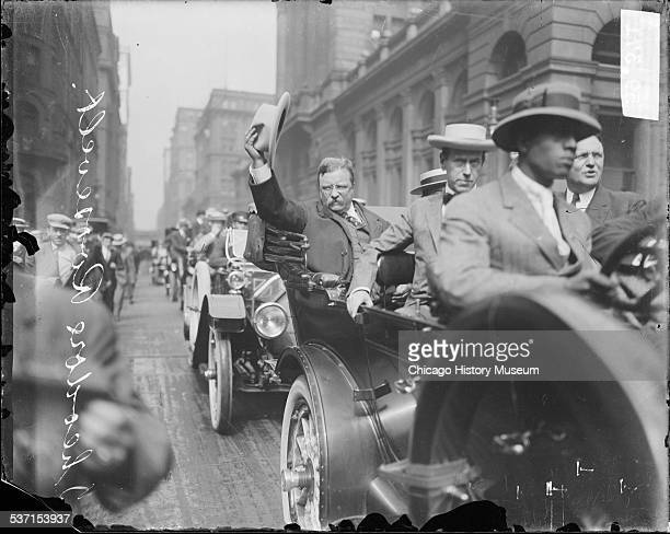 Theodore Roosevelt riding in an automobile in a procession along West Jackson Boulevard near the Federal Building Chicago Illinois August 6 1912 The...