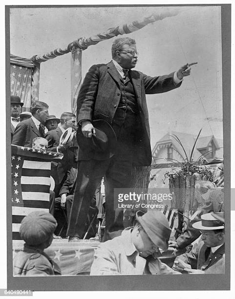 Theodore Roosevelt speaks from a platform during a political campaignprobably one of his own presidential campaigns Roosevelt a Republican first took...