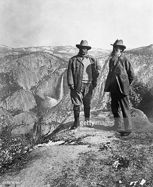 Theodore Roosevelt stands with naturalist John Muir on Glacier Point above Yosemite Valley California USA