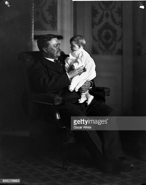 Theodore Roosevelt , the twenty-sixth President of the United States, holds a grandchild on his lap. Washington, D.C., ca. 1901-1909.