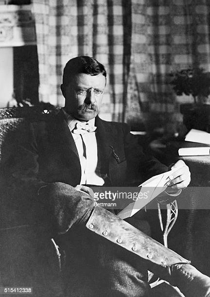 Theodore Roosevelt, wearing boots and seated with his legs crossed, reads a letter. Roosevelt , served as the 26th President of the United States ,...
