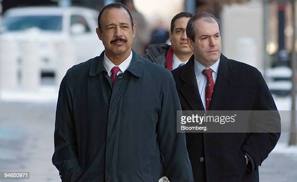 Theodore V Wells left attorney for I Lewis Scooter Libby arrives at US District Court in Washington DC for Libby's perjury trial Feb 7 2007 in...