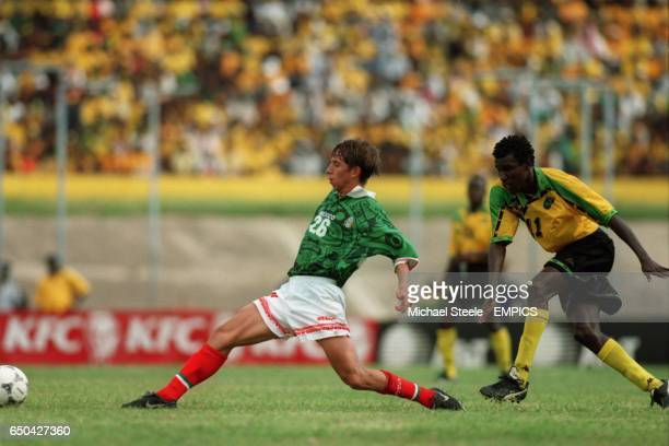 Theodore Whitmore of Jamaica shoots for goal before Paulo Cesar Chavez of Mexico can get a tackle in
