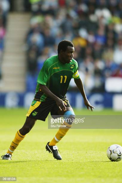 Theodore Whitmore of Jamaica turns with the ball during the International friendly match between Brazil and Jamaica on October 12 2003 at The Walkers...