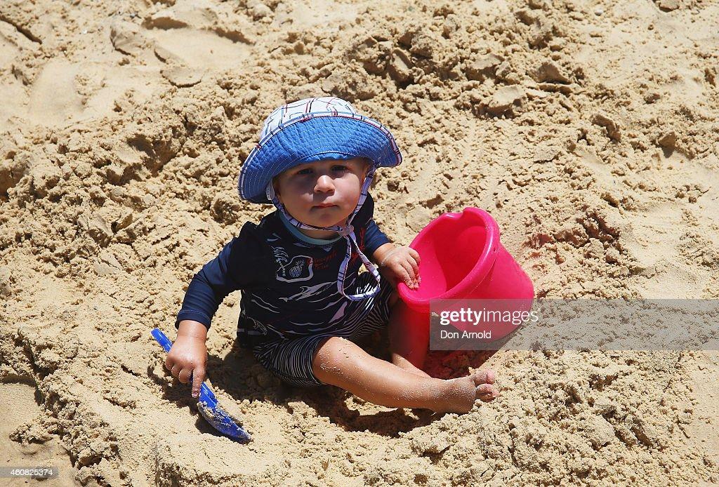 Theodore Zagora of North Bondi plays in the sand at Bondi Beach on December 25, 2014 in Sydney, Australia. Bondi Beach is a popular tourist destination on Christmas Day.
