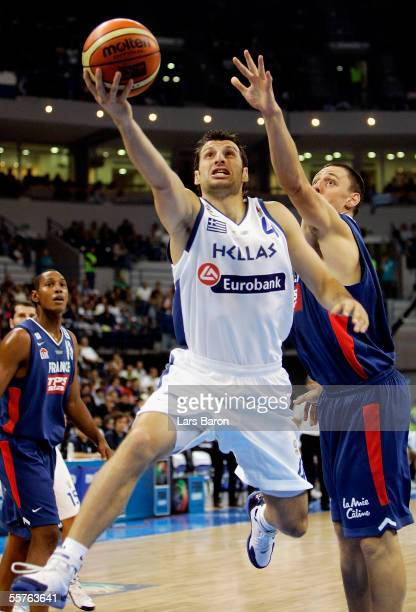 Theodoros Papaloukas of Greece in action with Cyril Julien of France during the FIBA EuroBasket 2005 semi final match between France and Greece on...