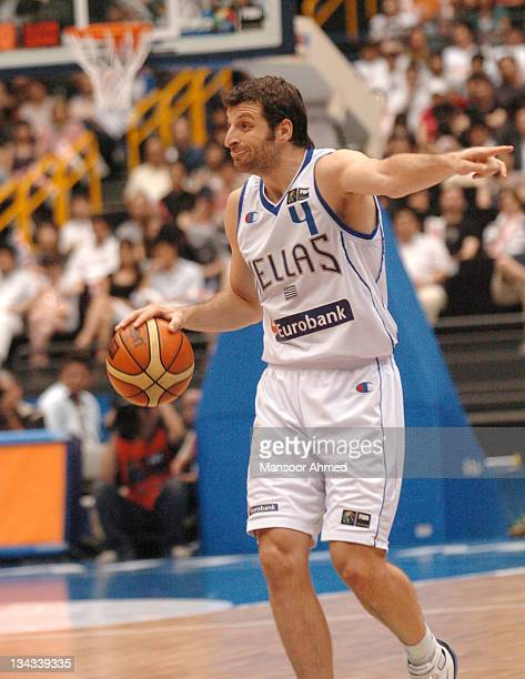 Theodoros Papaloukas of Greeces points the way for his team during the FIBA World Championship 2006 Final between Spain and Greece at the Saitama...