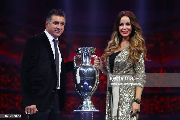 Theodoros Zagorakis Former Greece player and Joanna Lilli his wife pose for a photo with The Henri Delaunay Trophy after the UEFA Euro 2020 Final...