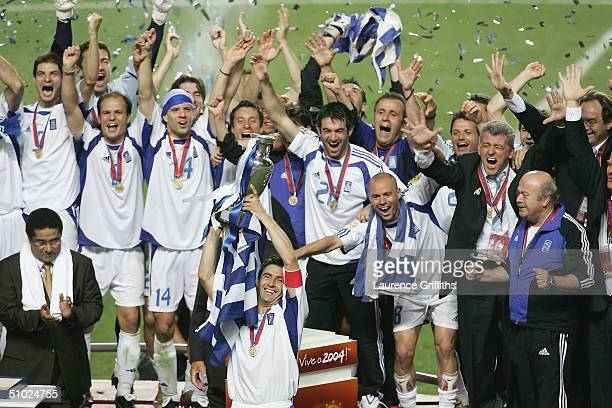 Theodoros Zagorakis of Greece celebrates with the trophy after winning the UEFA Euro 2004 Final match between Portugal and Greece at the Luz Stadium...