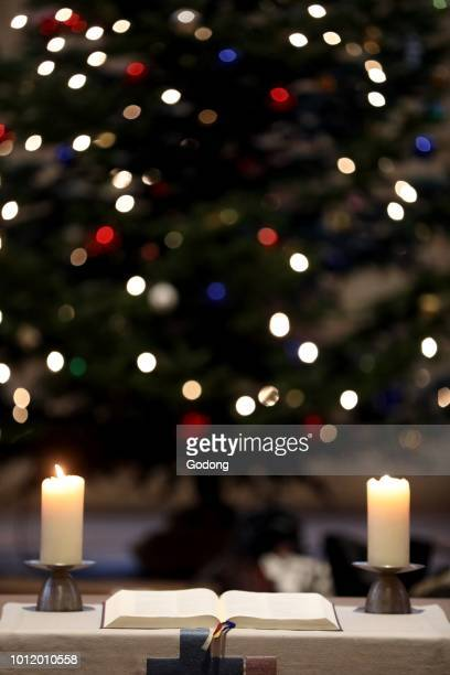 theodorskirche christmaas tree bible and church candles basel switzerland