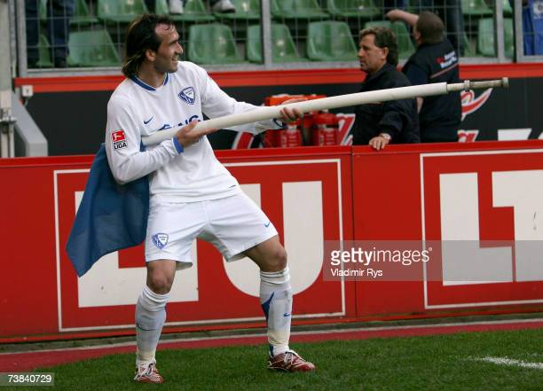Theofanis Gekas celebrates after scoring the fourth goal of Bochum during the Bundesliga match between Bayer Leverkusen and VFL Bochum at the...