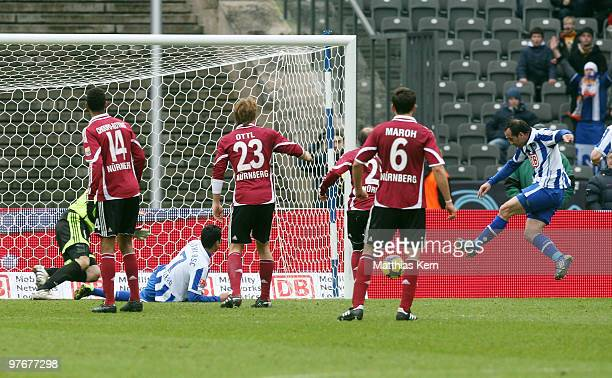 Theofanis Gekas of Berlin scores his team's first goal during the Bundesliga match between Hertha BSC Berlin and 1FC Nuernberg at Olympic Stadium on...
