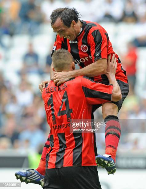 Theofanis Gekas of Frankfurt celebrates after scoring the 2:0 with his team mate Alexander Meier during the Bundesliga match between Borussia...