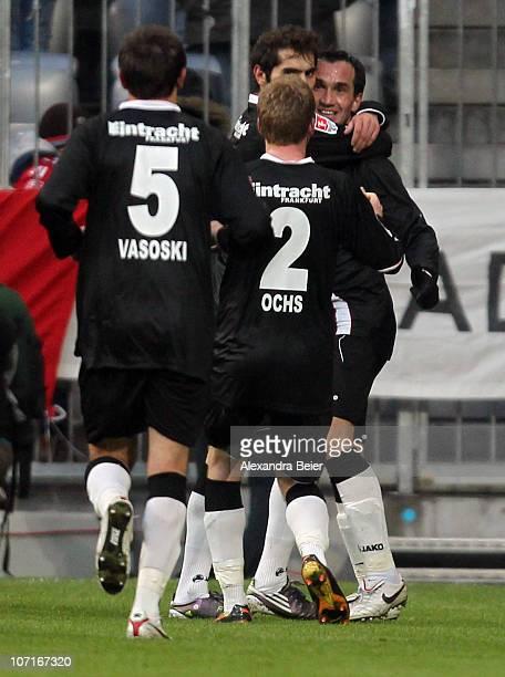 Theofanis Gekas of Frankfurt celebratesafter scoring his team's first goal with team mates during the Bundesliga match between FC Bayern Muenchen and...