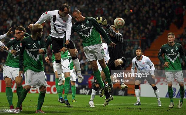 Theofanis Gekas of Frankfurt goes up for a header with Mikael Silvestre of Bremen during the Bundesliga match between SV Werder Bremen and Eintracht...