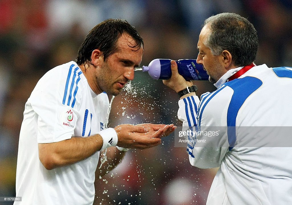 Theofanis Gekas of Greece is sprayed with water by medical staff during the UEFA EURO 2008 Group D match between Greece and Russia at Stadion Wals-Siezenheim on June 14, 2008 in Salzburg, Austria.