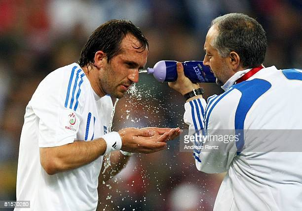 Theofanis Gekas of Greece is sprayed with water by medical staff during the UEFA EURO 2008 Group D match between Greece and Russia at Stadion...