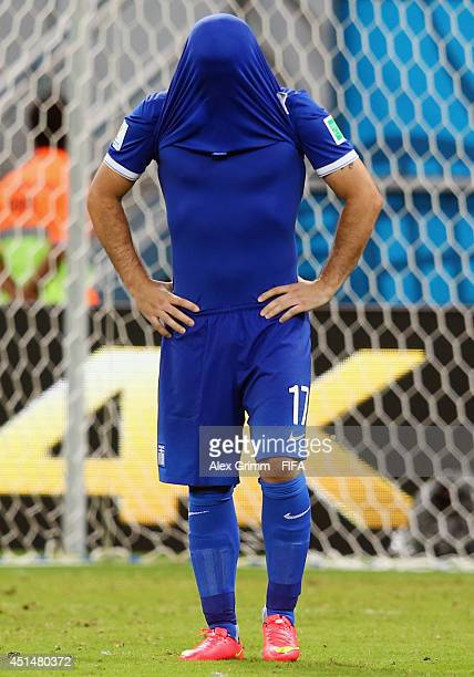 Theofanis Gekas of Greece reacts after his penalty being saved by Keylor Navas of Costa Rica in a penalty shootout during the 2014 FIFA World Cup...