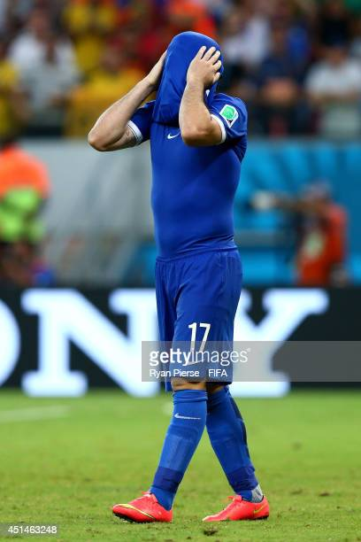 Theofanis Gekas of Greece reacts after his penalty kick saved in a penalty shootout during the 2014 FIFA World Cup Brazil Round of 16 match between...