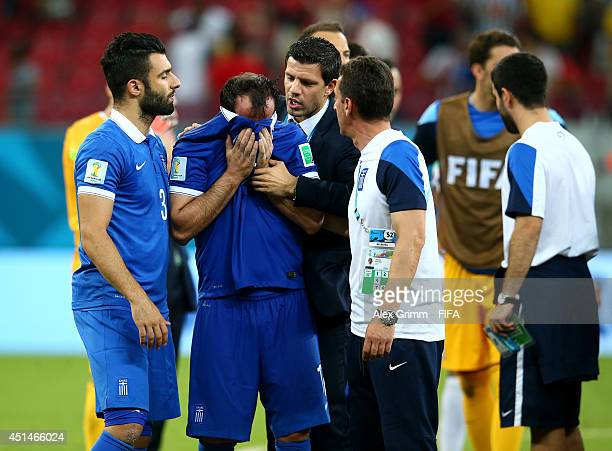 Theofanis Gekas reacts after the defeat in the 2014 FIFA World Cup Brazil Round of 16 match between Costa Rica and Greece at Arena Pernambuco on June...