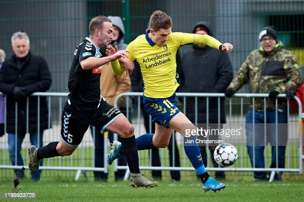 Theofanis Mavrommatis of SonderjyskE and Mikael Uhre of Brondby IF compete for the ball during the testmatch between Brondby IF and SonderjyskE at...