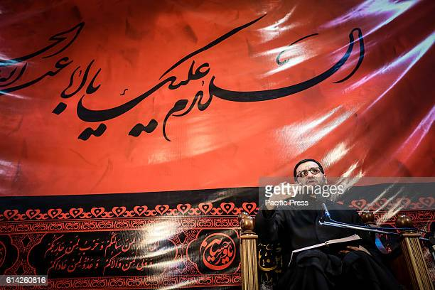 Theologian Imamjamaat of the mosque Meshedi Dadash Haji Shahin Hasanli speaks during a Ashura ceremony The mourning is associated with the tragic...