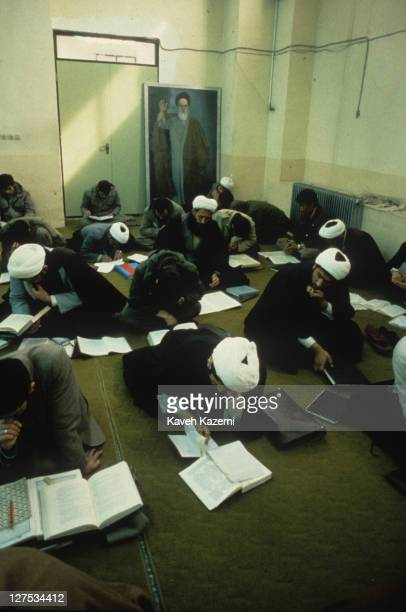 Theology students study Qoranic texts in a classroom at Feyzieh seminary in Qom, Iran, 1st February 1986. Qom is a major centre of Shi'ite Islam.