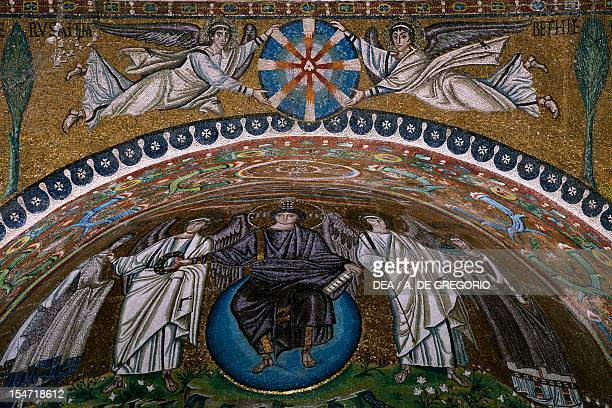 Theophany with Christ as the Redeemer San Vitale Bishop Ecclesius and two archangels and angels holding up a christological monogram mosaic apse and...