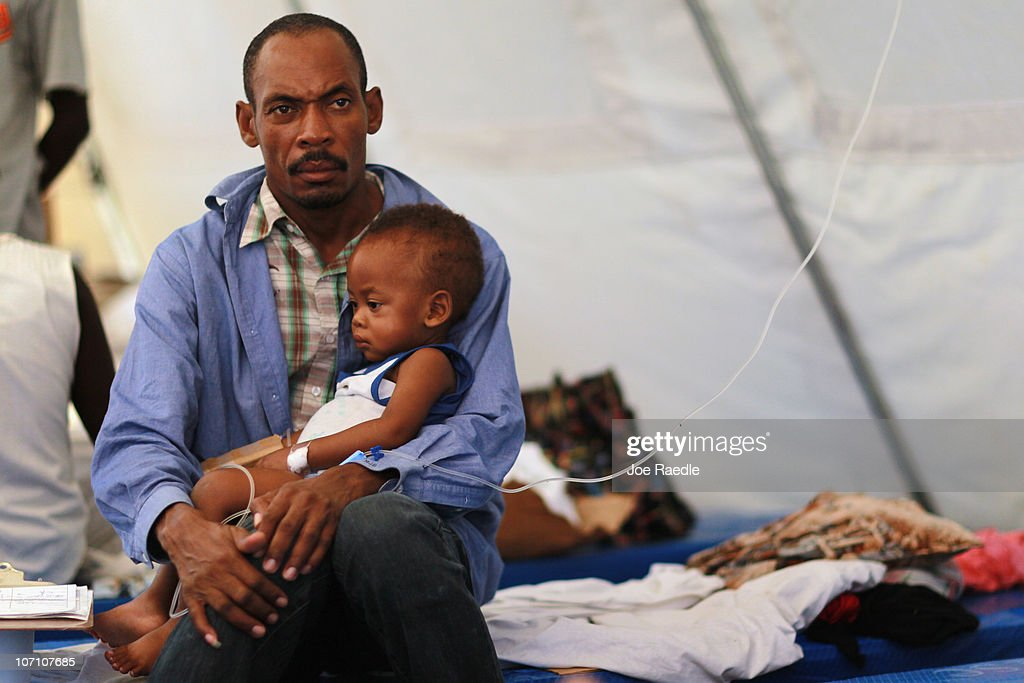 Theophil Gilot holds his son, Alexendro Gilot as the boy is being treated for cholera in a Samaritan's Purse cholera treatment facility on November 24, 2010 in Cabaret, Haiti. Haiti continues to deal with a cholera epidemic that has killed reportedly more than 1,400 with thousands more sick. Doctors say it is caused by poor sanitary conditions that make the bacteria easy to transmit through contaminated water or food.