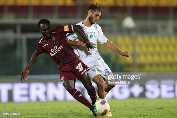 Theophilus Awua of AS Livorno Calcio battles for the ball with Filippo Bandinelli of FC Empoli during the serie B match between AS Livorno and FC...