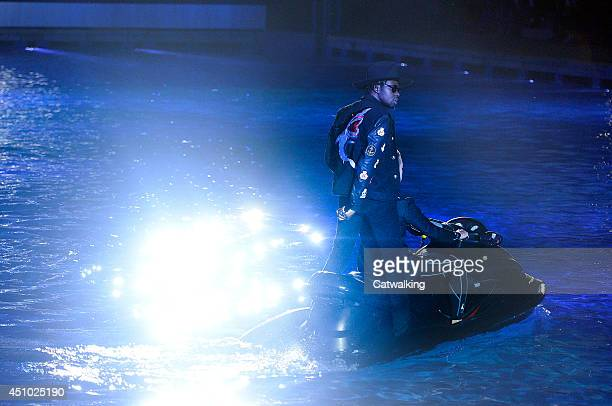 Theophilus London rapping from the back of a moving Jet Ski at the Philipp Plein Spring Summer 2015 fashion show during Milan Menswear Fashion Week...