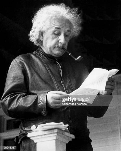 Theoretical physicist Albert Einstein reading a letter United States May 1938