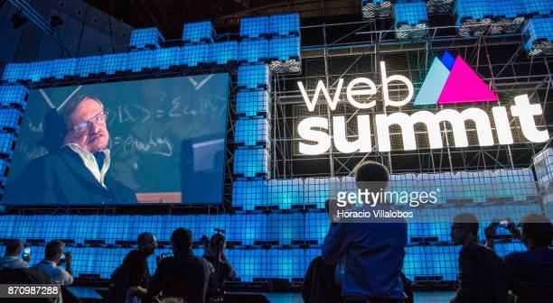 Theoretical physicist Stephen William Hawking's photo is shown on screen while he delivers remarks at the beginning of the opening night of Web...