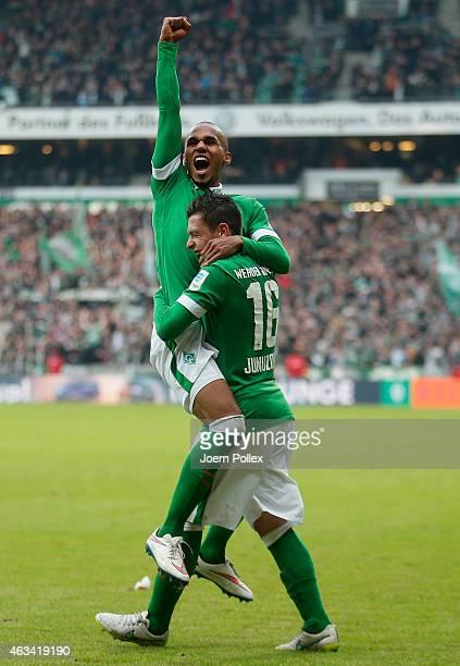 Theorod Gebre Selassie of Bremen celebrates with his team mate Zlatko Junuzovic after scoring his team's third goal during the Bundesliga match...