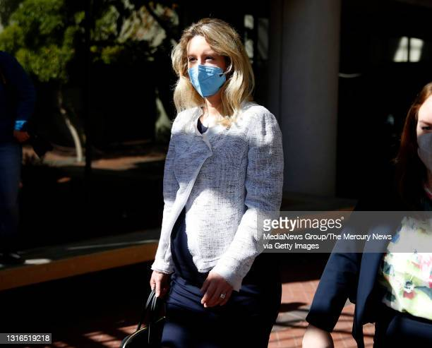 Theranos founder Elizabeth Holmes leaves the Robert F. Peckham Federal Building with her defense team in downtown San Jose, Calif., on Tuesday, May...