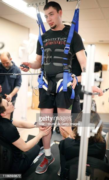 Therapist at the Mayo Clinic helped Jered Chinnock walk on a treadmill as he is recovering from a spinal cord injury Jered is part of study that...