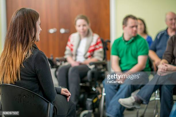 therapist leading a adult discussion - addict stock photos and pictures