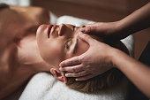 Therapist make anti age forehead wrinkles massage