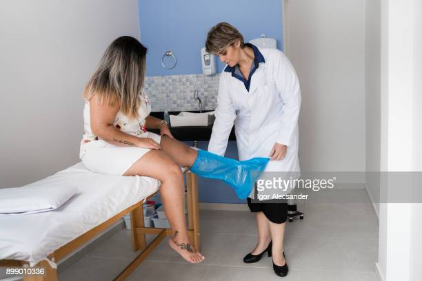 Therapist putting plastic boot for ozone application